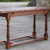 Console table in quarter-sawn oak with turned legs